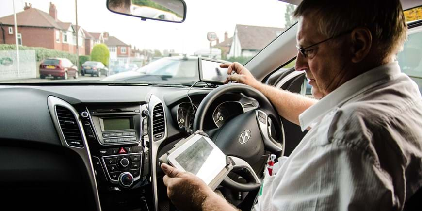 Man in car on tablet.jpg